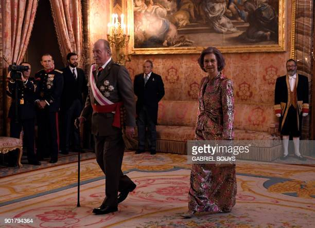 Former King of Spain Juan Carlos I and his wife former Queen Sofia attend the Epiphany Day celebrations at the Royal Palace in Madrid January 6 2018...