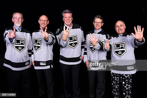Former Kings players Jay Wells Doug Smith Charlie Simmer Steve Bozek and Daryl Evans hold up numbers signifying the sequence of their goals from the...