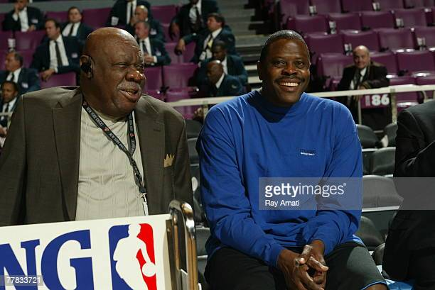 Former Knick Patrick Ewing talks with Cal Ramsey Director of Special Projects for the Knicks prior to the start of the game between the New York...