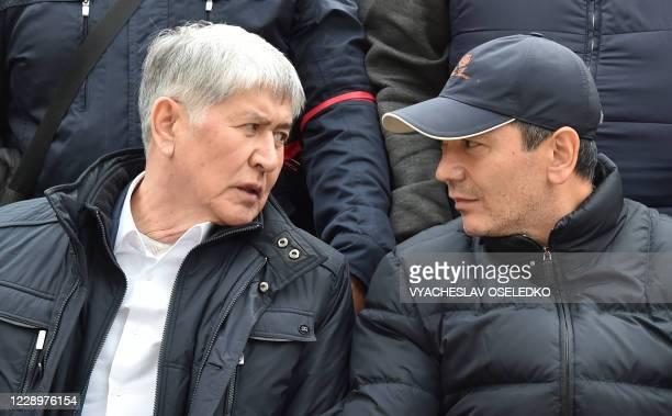 Former Kyrgyzstan President Almazbek Atambayev speaks with former Prime Minister Omurbek Babanov during a rally in Bishkek on October 9, 2020. - Two...