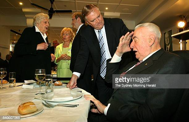 Former Labor Prime Minister Gough Whitlam talks with current federal Labor leader Kim Beazley at Whitlam's 90th birthday celebrations at Machiavelli...