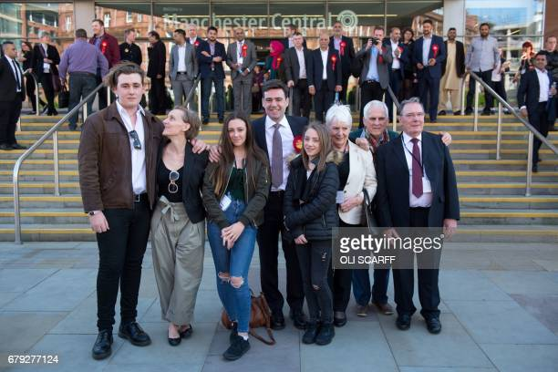Former Labour Cabinet minister Andy Burnham celebrates with his wife MarieFrance van Heel children Jimmy Annie and Rosie and his parents Eileen and...