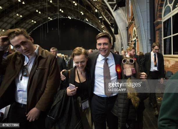 Former Labour Cabinet minister Andy Burnham celebrates with his wife MarieFrance van Heel children Jimmy and Annie after being elected as Mayor of...