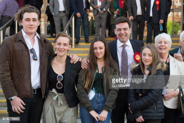 Former Labour Cabinet minister Andy Burnham celebrates with his wife MarieFrance van Heel children Jimmy Annie and Rosie and his mum Eileen outside...