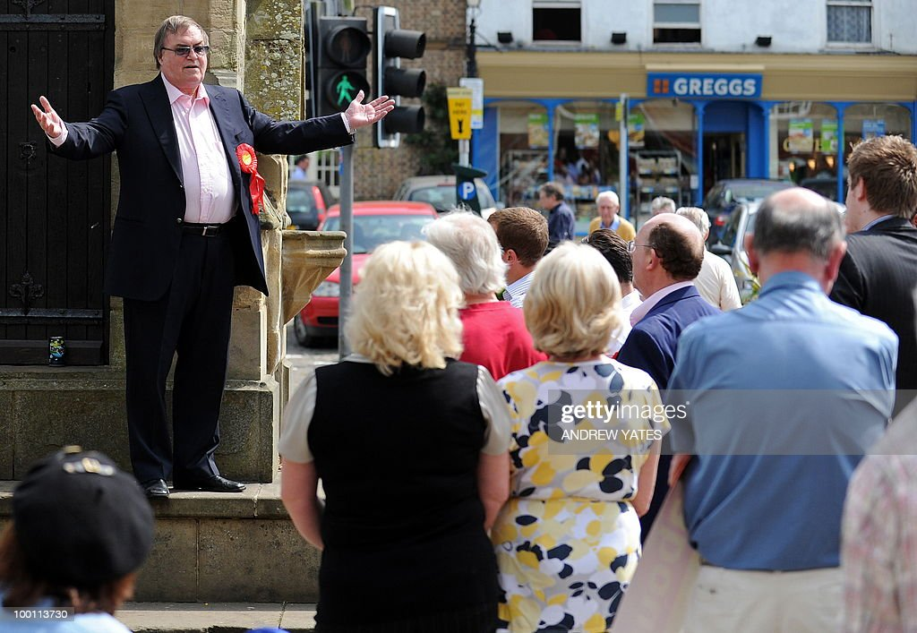 Former Labour Deputy Prime Minister, John Prescott gestures as he canvasses prospective voters with Labour's Jonathan Roberts (not pictured) during an election campaign visit to Thirsk in northern England on May 21, 2010. Prescott was canvassing with Roberts, Labour's prospective candidate for the Thirsk and Malton constituency seat, voting for which will take place on May 27, 2010.