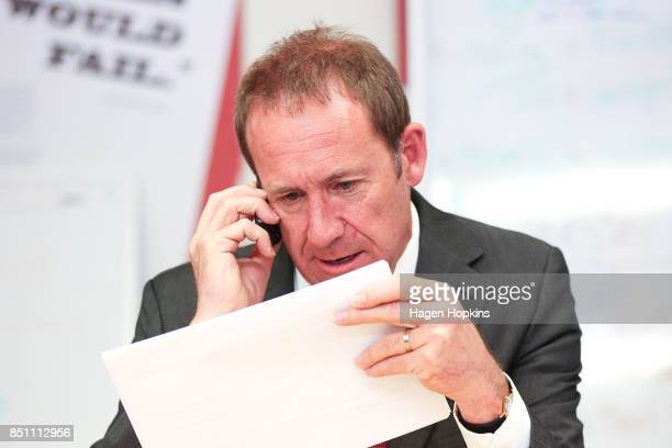 Former Labour leader Andrew Little makes a campaing call during a visit to Rongotai candidate Paul Eagle's phone bank on September 21 2017 in...