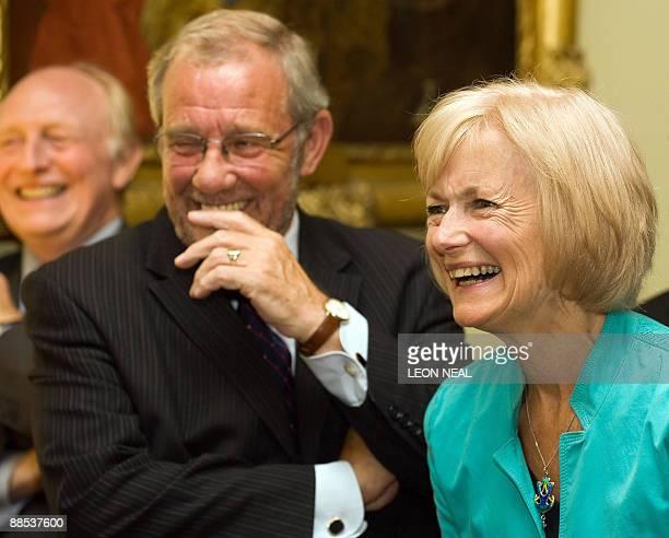 Former Labour leader Neil Kinnock MP Richard Caborn and Glenys Kinnock react to a joke as British Prime Minister Gordon Brown addresses a reception...