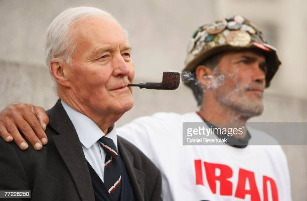 Former Labour MP Tony Benn stands with protestor Brian Haw during an AntiWar protest on October 8 2007 in London England Antiwar protesters marched...
