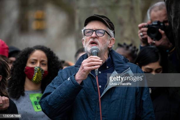 Former Labour Party Leader, Jeremy Corbyn, speaks to protesters next to a statue of Mahatma Gandhi at a Kill the Bill protest in Parliament Square on...