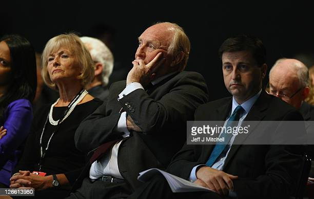 Former Labour Party Leader Neil Kinnock and his wife Glenys Kinnock sit with Shadow Foreign Secretary Douglas Alexander during the Labour party...