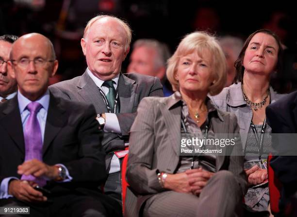 Former Labour Party Leader Neil Kinnock sits behind his wife Glenys Kinnock at The Labour Party Conference on September 28 2009 in Brighton England...