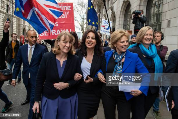 Former Labour Party MP Joan Ryan links arms with former Conservative MP's Heidi Allen Anna Soubry and Sarah Wollaston as they arrive to a press...