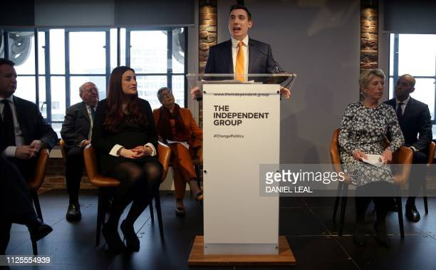 Former Labour party MPs Chris Leslie Mike Gapes Luciana Berger Ann Coffey Angela Smith and Chuka Umunna listen as Gavin Shuker speaks during a press...