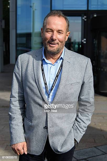 Former Labour politician Derek Hatton leaves a restaurant after meeting Len McLuskey of Unite the Union during the Labour Party conference on...