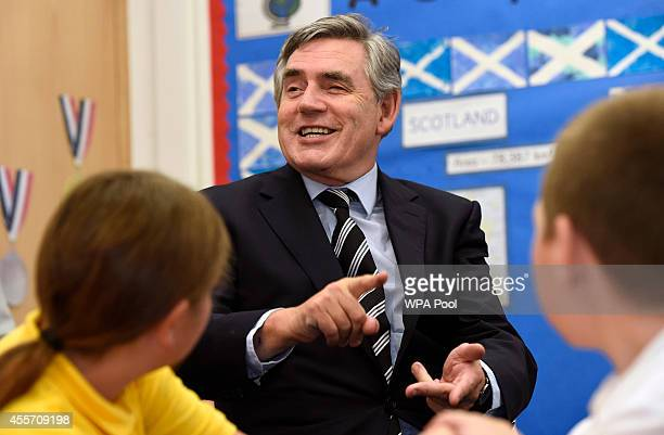 Former Labour Prime Minister Gordon Brown meets and chats to pupils from the schools primary 7 class during his visit to Kelty Primary school...