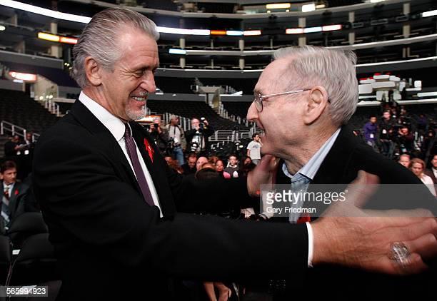 Former Laker coaches Pat RIley greets Bill Sharman at a news conference on the 20th anniversary of Magic Johnson's departure from basketball at...
