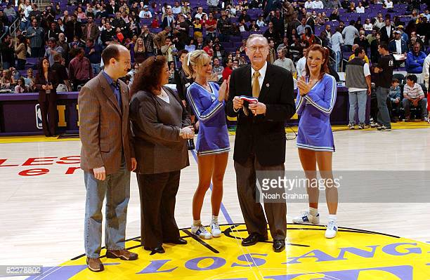Former Lakers head coach Bill Sharman is honored during halftime on 'Vintage Night' of the Los Angeles Lakers game against the Dallas Mavericks on...