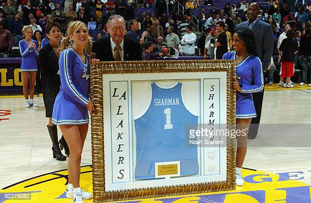 Former Lakers Head Coach Bill Sharman is honoured at halftime on 'Vintage Night' at the Los Angeles Lakers v the Dallas Mavericks on March 4 2005 at...