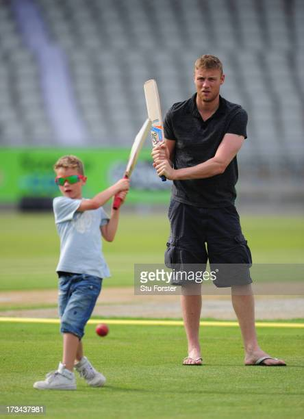 Former Lancashire and England player Andrew 'Freddie' Flintoff looks on as his son Corey plays a shot after the Friends Life T20 match between...