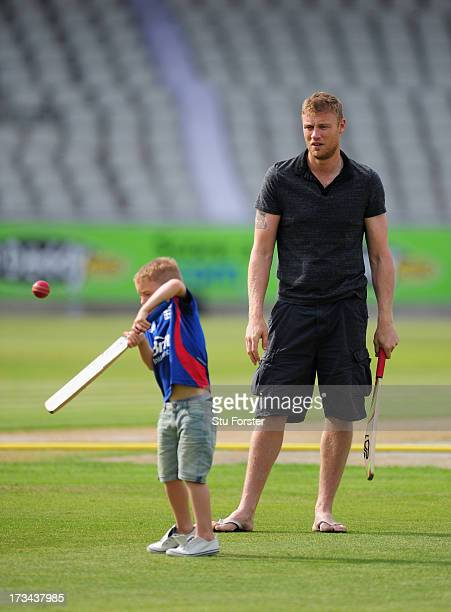 Former Lancashire and England player Andrew 'Freddie' Flintoff looks on as his son Rocky plays a shot after the Friends Life T20 match between...