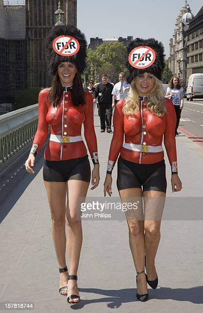 Former Lara Croft Model Lucy Clarkson And Peta Model Victoria Eisermann Pose On Westminster Bridge To Protest Against The Queen'S Guards' Wearing...