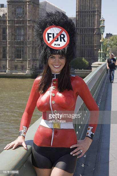 Former Lara Croft Model Lucy Clarkson Poses On Westminster Bridge To Protest Against The Queen'S Guards' Wearing Real Bearskins Westminster London