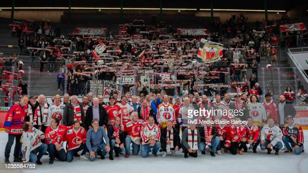 Former Lausanne HC players take the pose for a picture in front of the fans after the Swiss National League game between Lausanne HC and SC Bern at...