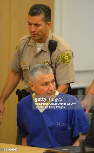 Former LAUSD teacher Robert Pimentel is taken into custody after he was sentenced to 12 years in prison in Long Beach CA on Thursday June 19 2014...