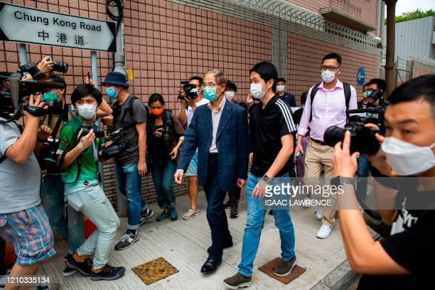 Former lawmaker and prodemocracy activist Martin Lee leaves the Central District police station in Hong Kong on April 18 after being arrested and...