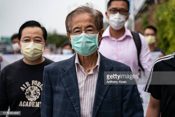Former lawmaker and prodemocracy activist Martin Lee leaves the Central District police station in Hong Kong after being arrested on April 18 2020 in...