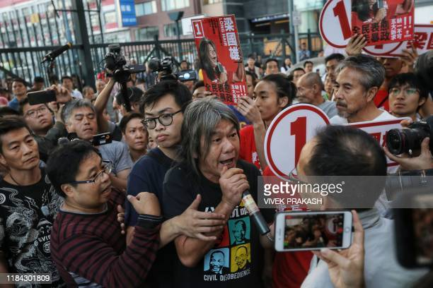 Former lawmaker Leung Kwokhung also known as long hair argues with supporters of proBeijing candidate Starry Lee during the district council...