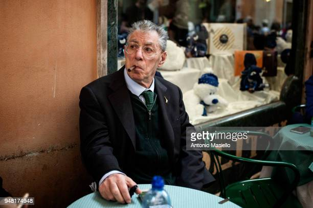 Former leader and founder of Lega political party Umberto Bossi smokes a cigar during a new day of meetings for the formation of the new government...