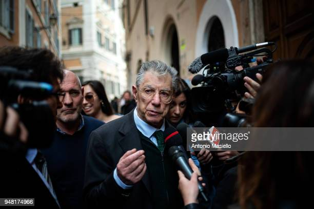 Former leader and founder of Lega political party Umberto Bossi speaks with journalists during a new day of meetings for the formation of the new...