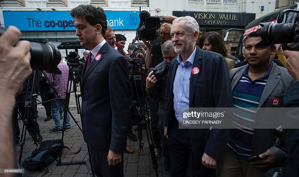 Former Leader of Britain's opposition Labour Party, Ed Miliband, (L) listens as the current leader, Jeremy Corybn, arrive to deliver speeches on the merits of Britain remaining in the European Union (EU), in Doncaster on May 27, 2016. With just under four weeks to go until the June 23 referendum, the Remain camp is on 53 percent and the Leave campaign on 47 percent, according to the What UK Thinks website's average of the most recent six opinion polls. / AFP / Lindsey Parnaby