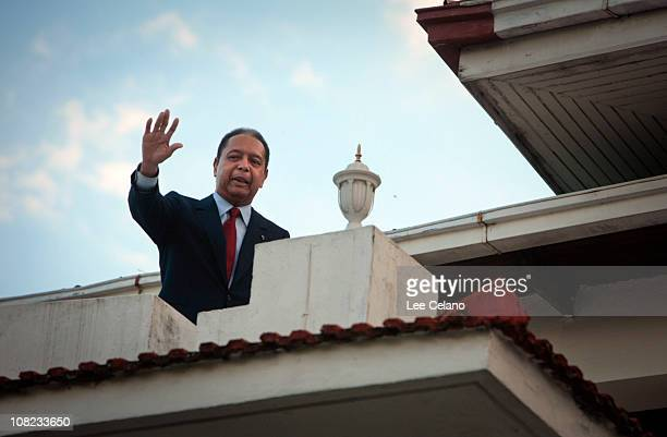 """Former leader of Haiti Jean-Claude """"Baby Doc"""" Duvalier waves from a balcony following a press conference at his house in Petionville January 21, 2010..."""