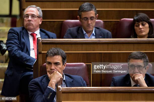 Former leader of Spanish Socialist Party Pedro Sanchez listens to the speech by Spanish acting Prime Minister Mariano Rajoy during the start of the...