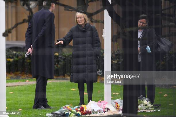 Former Leader of the House of Commons Harriet Harman speaks with a colleague after viewing floral tributes laid within the grounds of the Houses of...