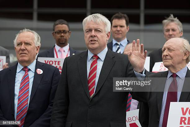 Former Leader of the Labour Party Neil Kinnock and Peter Hain listen as the First Minister of Wales Carwyn Jones speaks as they attend a Remain call...