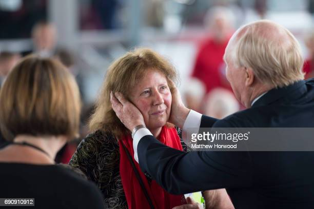 Former leader of the Labour party Neil Kinnock greets Rhodri Morgan's wife Julie Morgan during the funeral of former First Minister of Wales Rhodri...