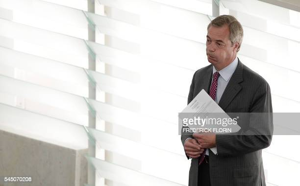 Former leader of the United Kingdom Independence Party Nigel Farage reacts as he arrives for a voting session at the European Parliament during the...