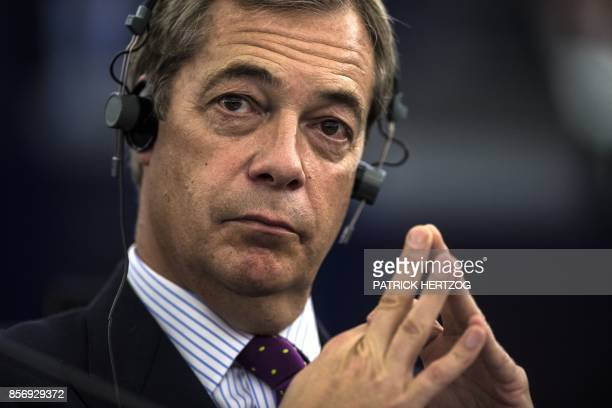 Former leader of UK Independence Party Nigel Farage follows a debate on the progress of the Brexit talks at the European Parliament in Strasbourg...