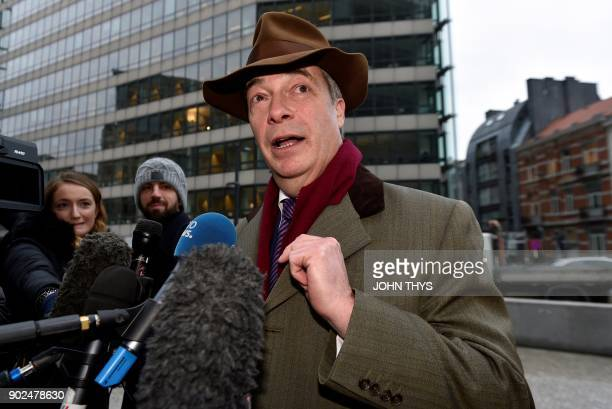 Former leader of UK Independence Party Nigel Farage speaks to journalists ahead of a meeting with European Commission member in charge of Brexit...