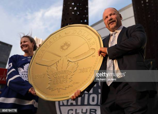 TORONTO ON OCTOBER 7 Former Leafs captain Wenel Clark and Royal Canadian Mint President and CEO Sandra Hanington unveil the new Canadian 1 dollar...