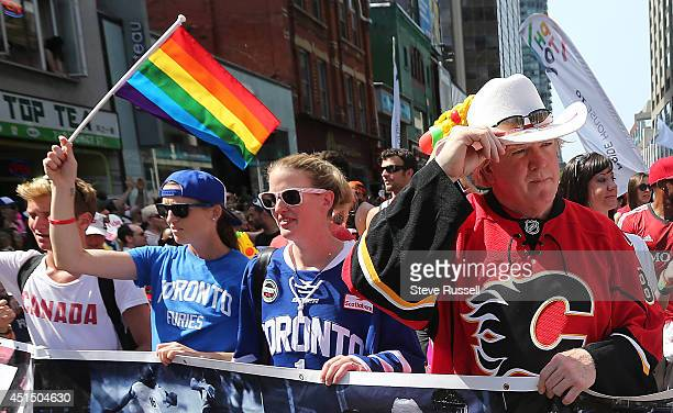 TORONTO ON JUNE 29 Former Leafs GM Brian Burke walks with You Can Play during the WorldPride 2014 parade hosted by Pride Toronto along Yonge Street...