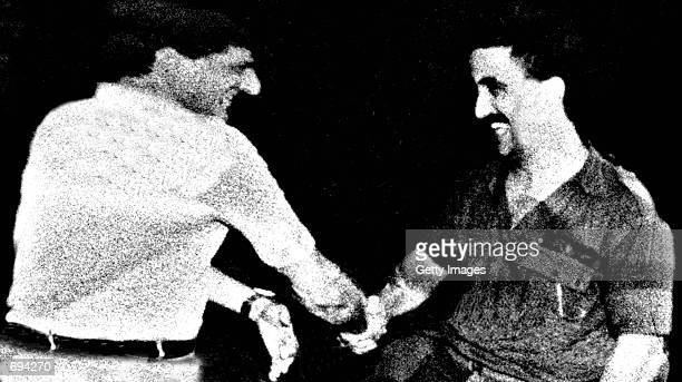 Former Lebanese Christian warlord Elie Hobeika is seen in this undated photo shaking hands with assassinated Lebanese President Bashir Gemayel The...