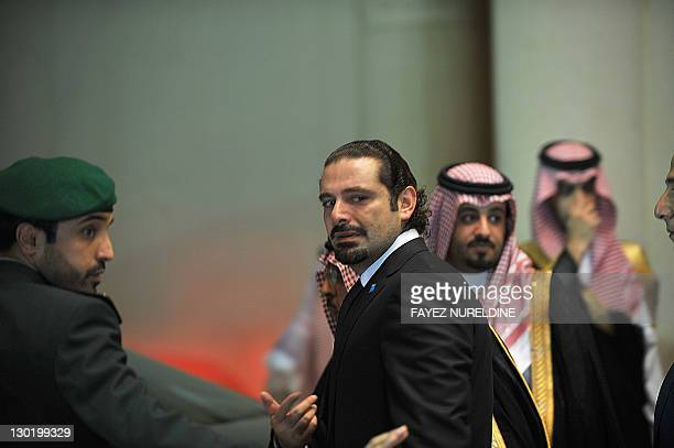 Former Lebanese prime minister Saad Hariri arrives to attend a mourning ceremony held by the Saudi royal family at the Riyadh air base upon the...