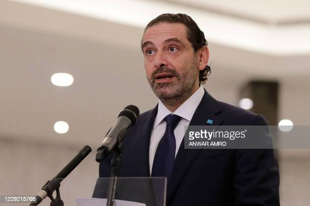 Former Lebanese prime minister Saad Hariri delivers a statement after the president named him to form a new cabinet, at the presidential palace in...