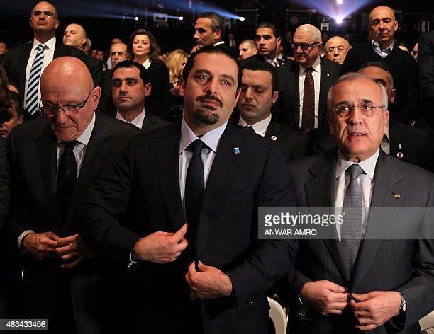 Former Lebanese prime minister Saad Hariri flanked by Lebanese Prime Minister Tammam Salam and former Lebanese president Michel Sleiman attends a...