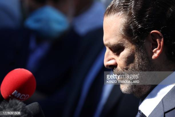 Former Lebanese prime minister Saad Hariri, reacts and speaks to the press as he leaves the UN-backed Special Tribunal for Lebanon at Leidschendam on...