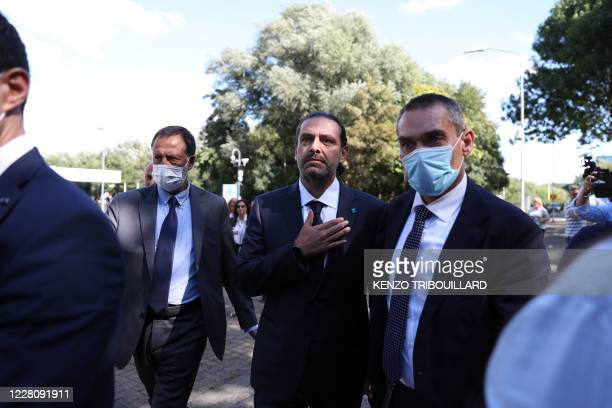 Former Lebanese prime minister Saad Hariri, reacts as he leaves the UN-backed Special Tribunal for Lebanon at Leidschendam on August 18 after the...